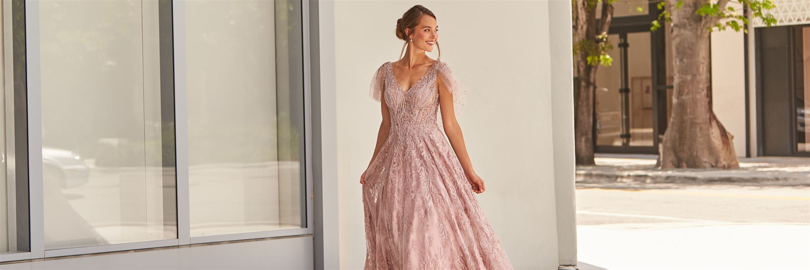 Model wearing pale pink mother of the bride dress